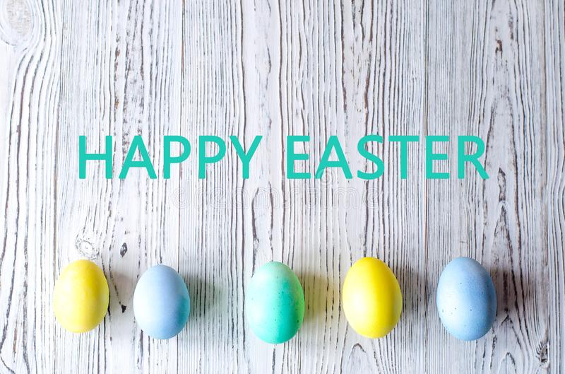 Multicolored easter eggs on wooden background stock photo