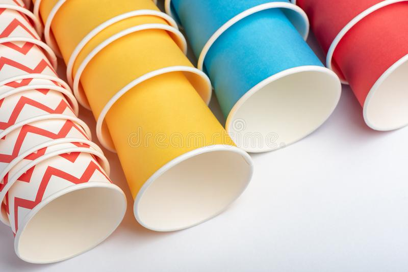 Multicolored eco paper party cups on white background stock photo