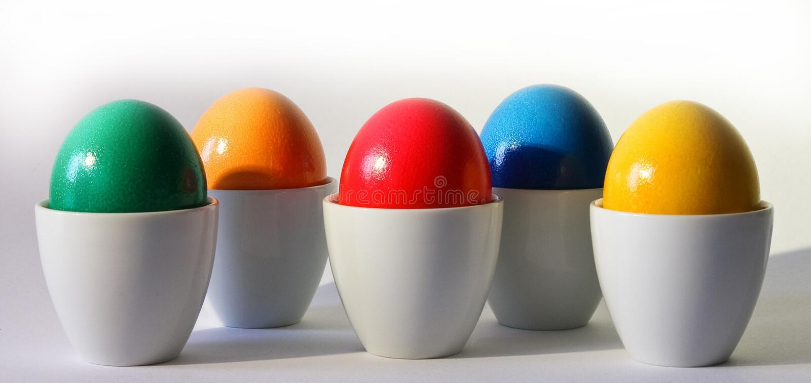 Multicolored Egg Ornament on White Desk royalty free stock photography