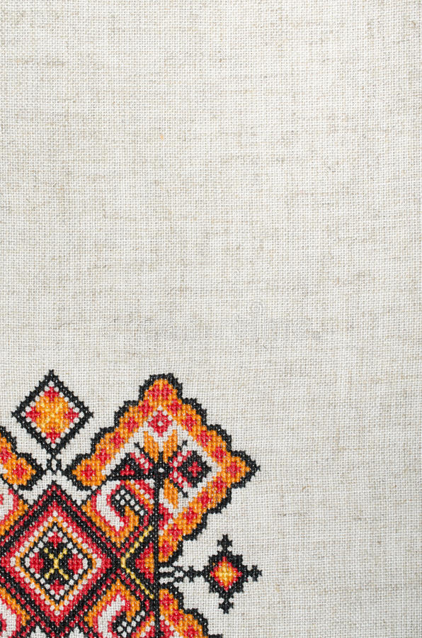 Multicolored embroidered element on linen cotton threads royalty free stock photos