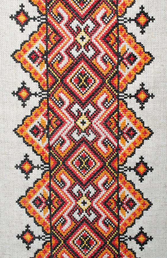 Multicolored embroidered element on linen cotton threads. Colorful ornament embroidered on linen cotton yarns royalty free stock photography