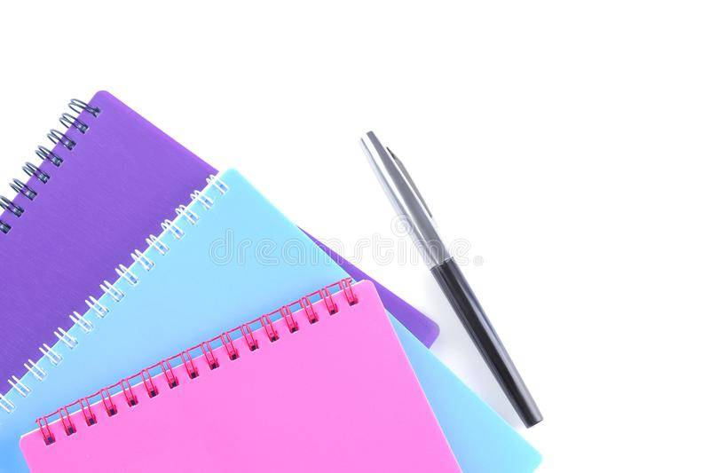 exercise book and pen on white isolated background. View from above. School supplies royalty free stock photography