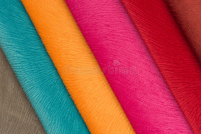 Multicolored Fabric Swatches. A close-up of multicolored fabric swatches stock images