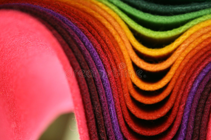 Multicolored fabrics stock images