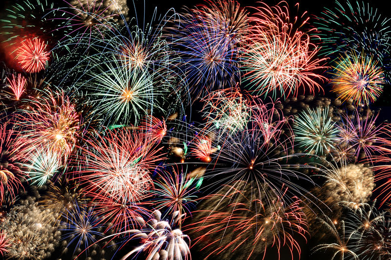 Multicolored fireworks fill the frame stock photos