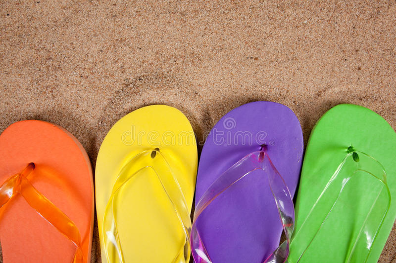 Download Multicolored Flipflops In The Sand Stock Photo - Image: 11375820