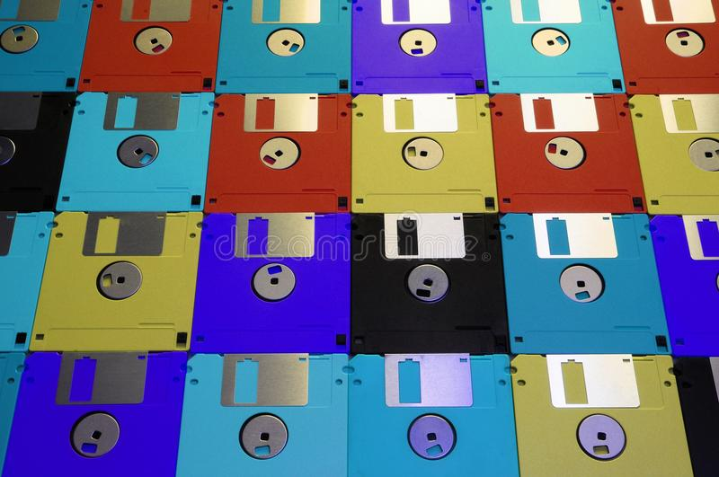Multicolored floppy disc 3.5 for old computers. Aligned as background stock images