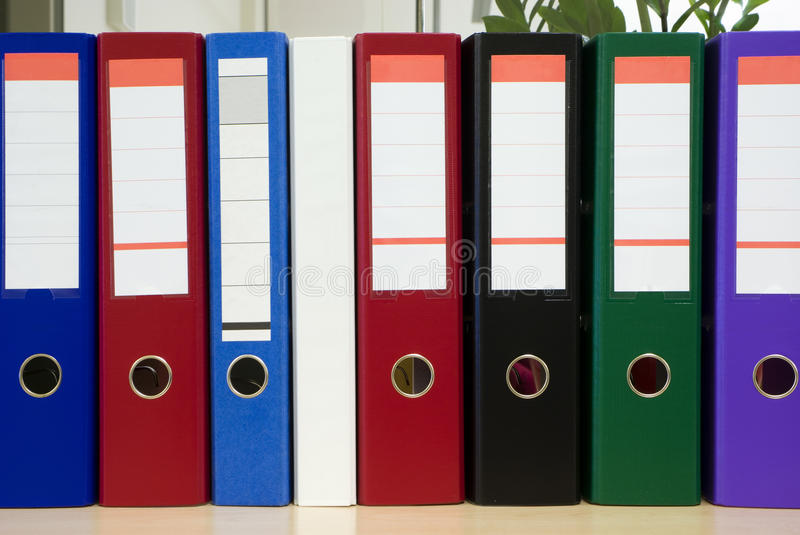 Download Multicolored Folders Standing On A Shelf Stock Photo - Image: 16037134