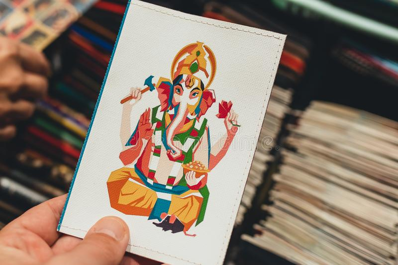 Multicolored Ganesha printed on passport cover. stock photography