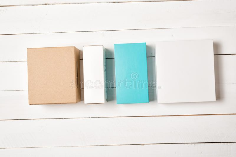 Multicolored gift boxes on a light wooden background. Flat lay.  royalty free stock photography