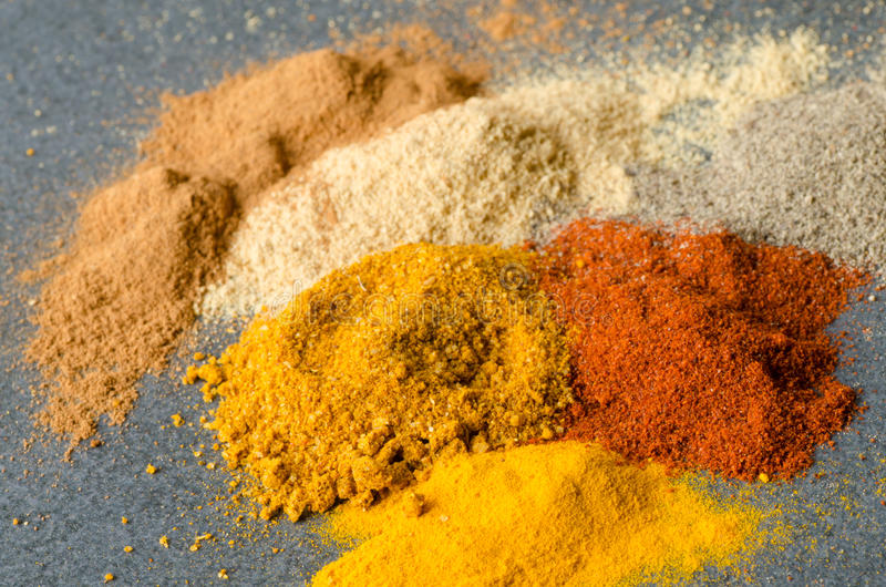 Multicolored ground spices. Turmeric paprica pepper ginger chilli stock photography