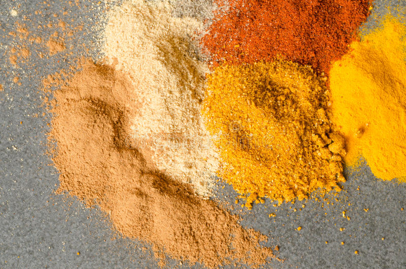 Multicolored ground spices. Turmeric paprica pepper ginger chilli royalty free stock image