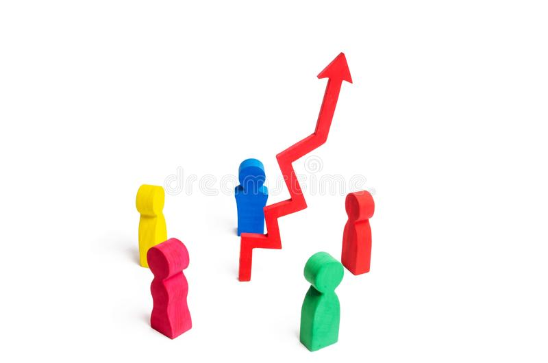 A multicolored group of people stands around the arrow up. Concept of business success. Increase sales and ranking, improve qualit royalty free stock image