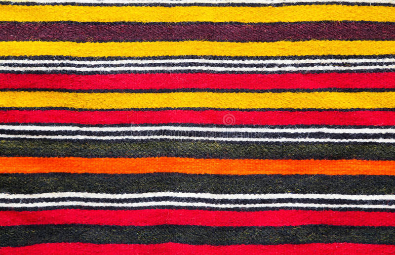 Multicolored handmade woollen rug texture royalty free stock photo