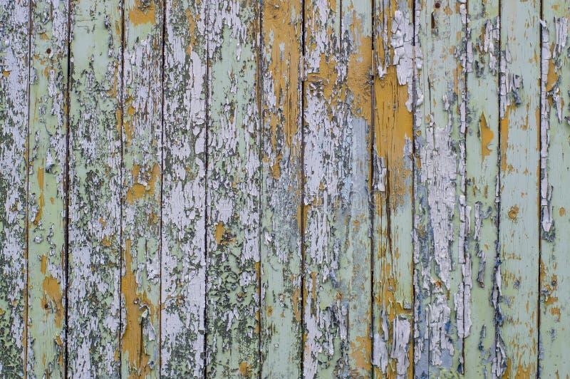 Multicolored heldere oude planken met gebarsten verf royalty-vrije stock afbeeldingen