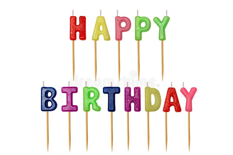 Multicolored inscription Happy birthday candles letters on wooden stick isolate on white background.  stock photos