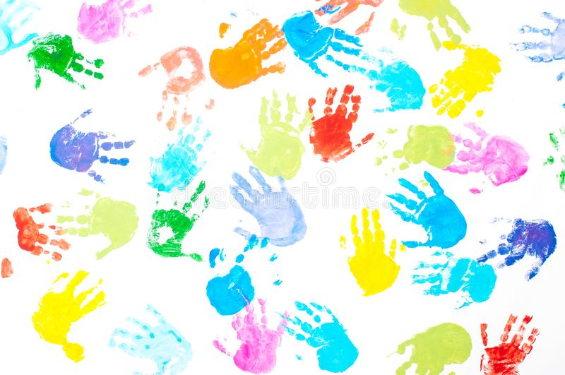 Multicolored kids handprints on white background stock image