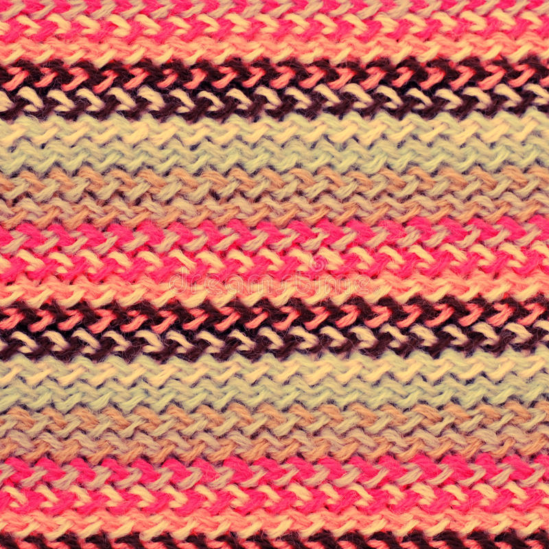Multicolored knitting horizontal striped background. Multicolored knitting horizontal striped wool texture. may be used as background. Vintage toned image stock images
