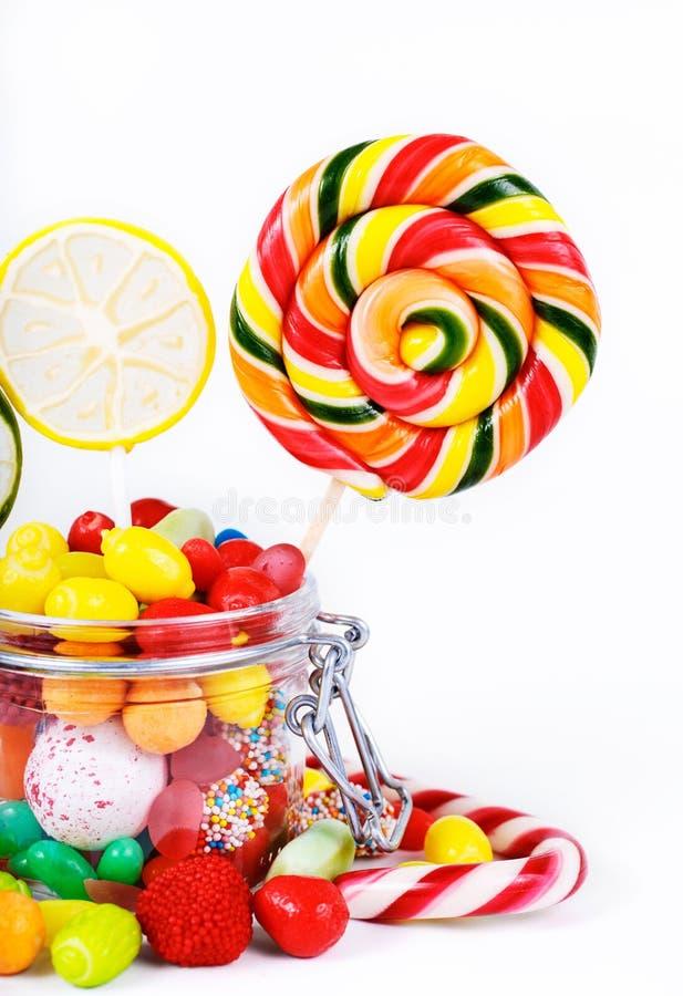 Multicolored lollys, suikergoed en kauwgom stock afbeeldingen