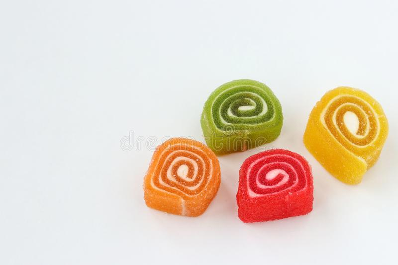 Multicolored marmalade is located on a white background, horizontal photo stock images