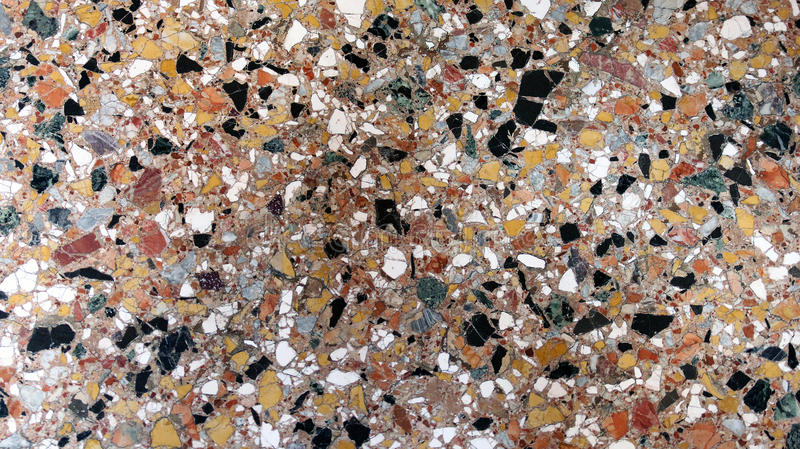 Multicolored mosaic polished floor from many pieces of color stone royalty free stock image