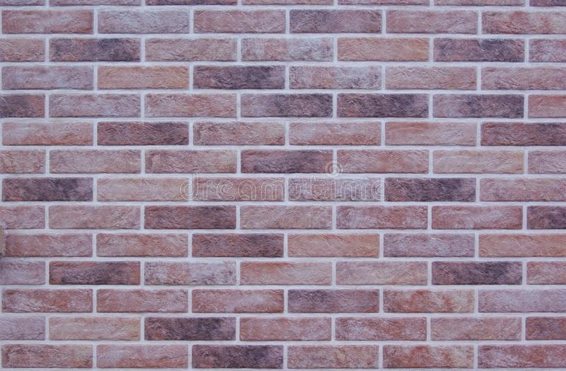 Multicolored motley bricks wall image background or texture stock image