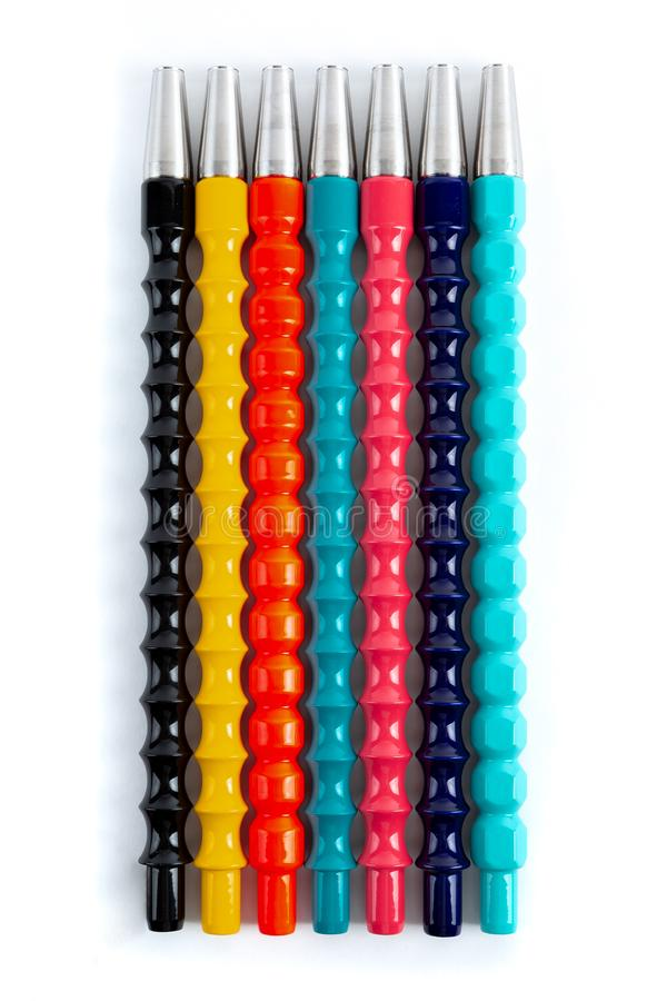 Multicolored mouthpieces for hookah. View from above. White background.  royalty free stock photos