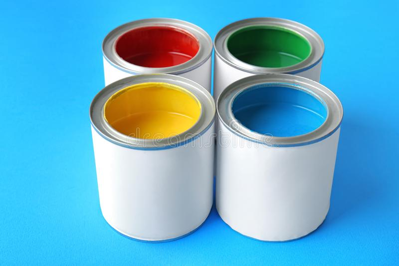 Multicolored paint in tin cans royalty free stock photos