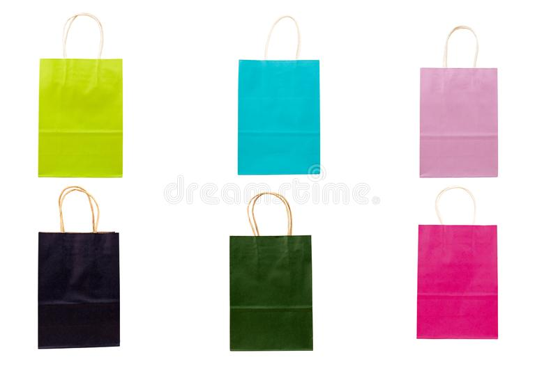 Multicolored paper bags for shopping isolated on white. Purchase, gift, buy, commerce, design, green, merchandise, packet, present, retail, sale, different stock photography