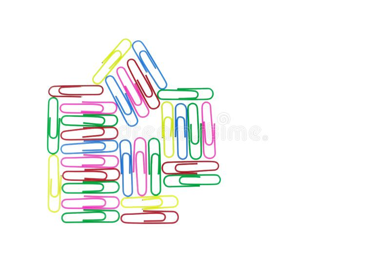 Multicolored paper clips in the form of a house on white background. Decorative paper clips in pink, yellow, green, red and blue. Colors. Multicolored paper stock photos