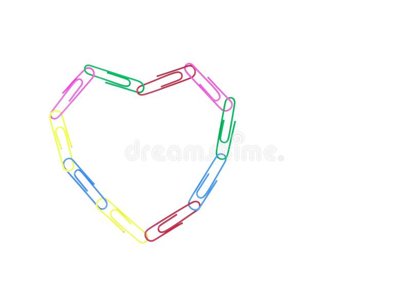 Multicolored paper clips with love sign heart shape on white background. Decorative paper clips in pink, yellow, green, red and. Blue colors. Multicolored paper royalty free stock images
