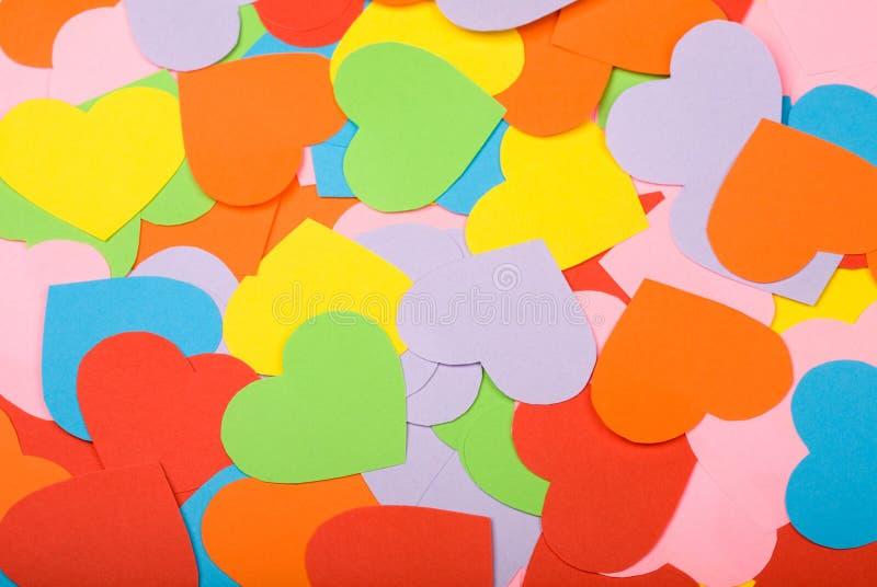 Multicolored paper hearts stock image