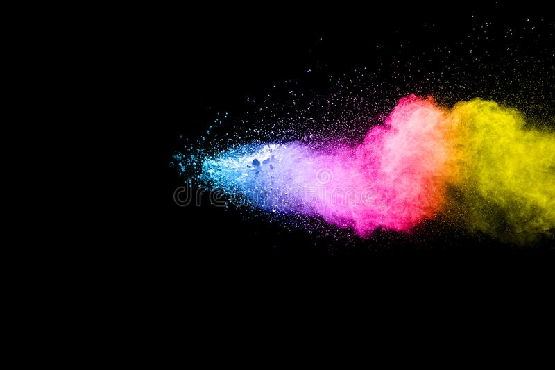 Multicolored particles explosion on black background. royalty free stock photo