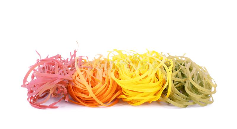 Multicolored pasta tagliatelle on white background royalty free stock photos