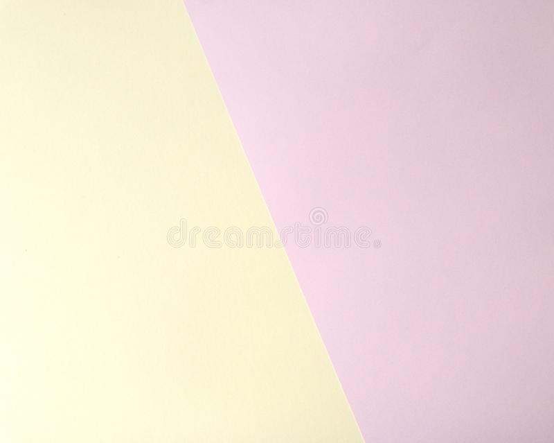 Multicolored pastel yellow pink paper geometric background with photo frame. stock photo