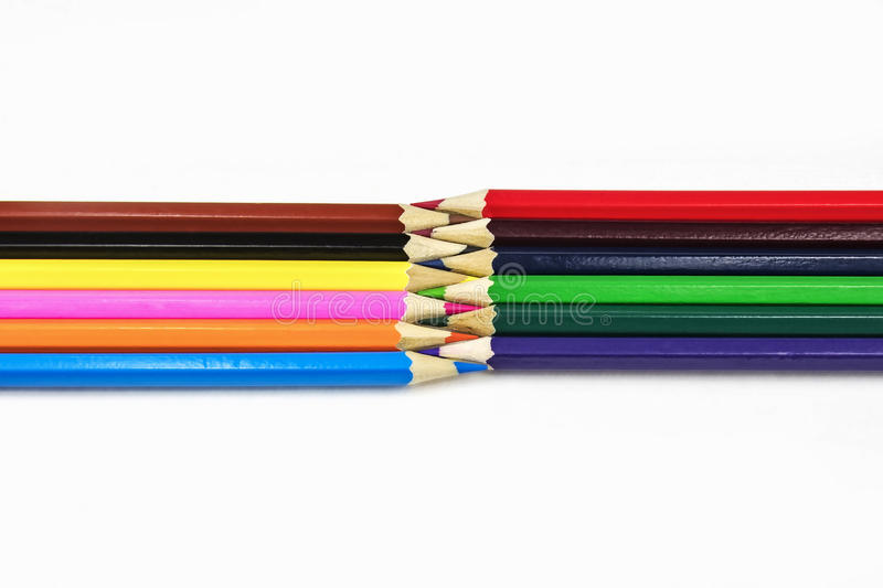Multicolored pencils lie on a white background. On a white background there are multicolored sharpened pencils for drawing royalty free stock images