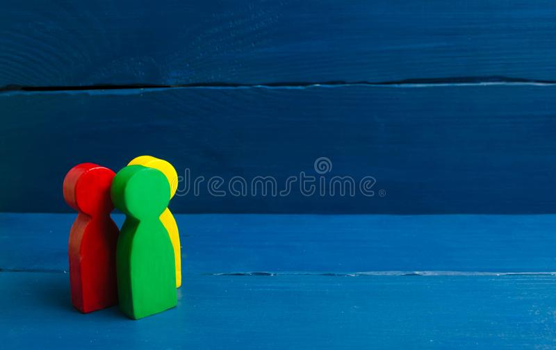 Multicolored people stand on a blue background. The concept of community and unity. Team, cooperation and teamwork. royalty free stock image
