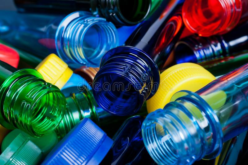 Multicolored PET preforms for plastic bottle on white background stock photography