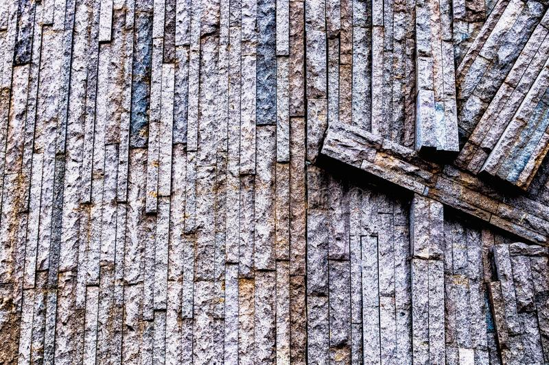 Multicolored photo background, wallpaper in stone stripes, abstract photo. Bricks on the wall stock photos