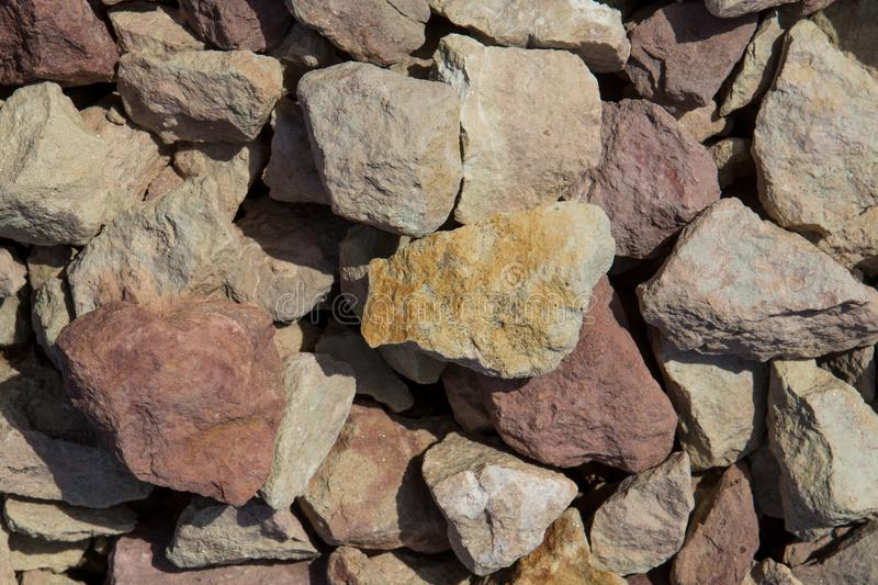 Multicolored pieces of large slate stone on a slant the afternoon. Multicolored pieces of large slate stone on a slant in the afternoon royalty free stock photo