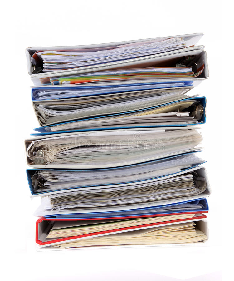 Multicolored pile of binders / files with papers royalty free stock photography