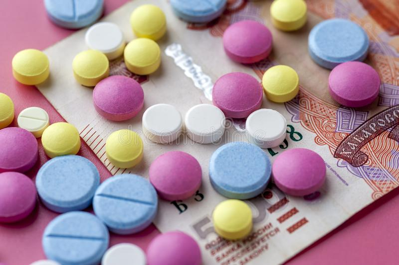 Concept Of Costs on Health Promotion And Medical Treatment. Multicolored Pills on Thousand Rubl Bills. Concept Of Costs on Health Promotion And Medical Treatment stock photos