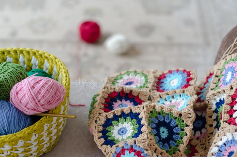 Multicolored plaid squares of crocheted royalty free stock photo