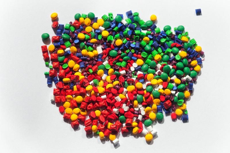 Multicolored plastic granules royalty free stock photo