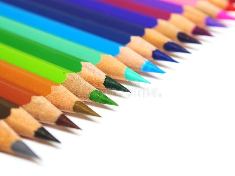 Multicolored potloden die op witte achtergrond worden geïsoleerdk royalty-vrije stock afbeeldingen