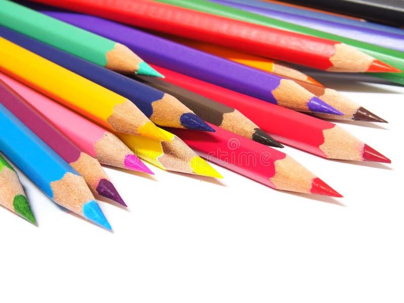 Multicolored potloden die op witte achtergrond worden geïsoleerdk stock foto