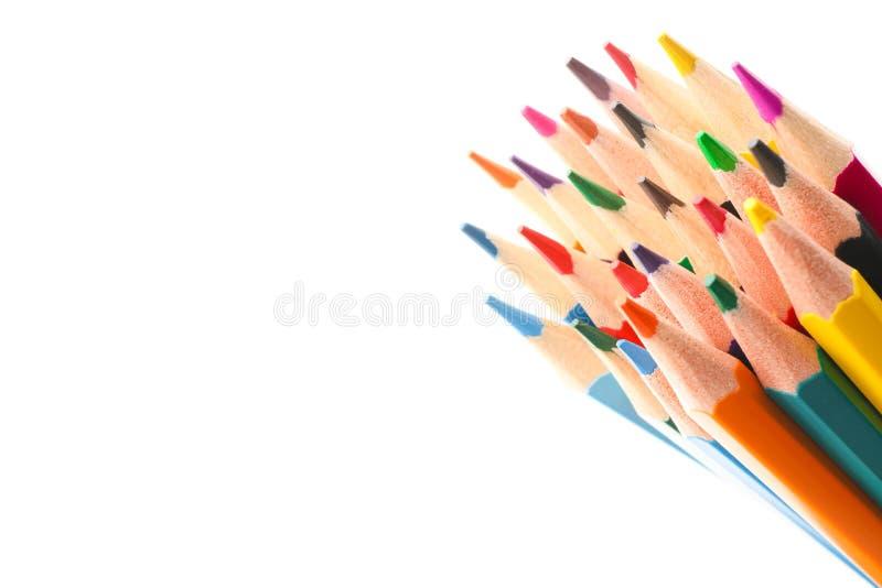 Multicolored potloden die op witte achtergrond worden ge?soleerdk stock fotografie