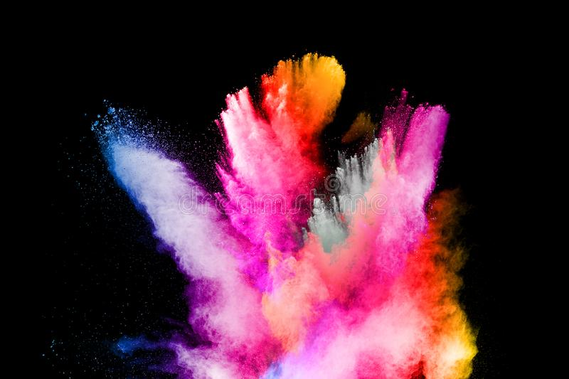 Multicolored powder explosion on black background.Color dust splash cloud on dark background.Launched colorful particles stock photo