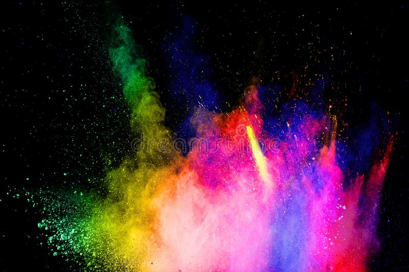 Multicolored powder explosion on black background.Abstract colorful dust particles textured background royalty free stock photos