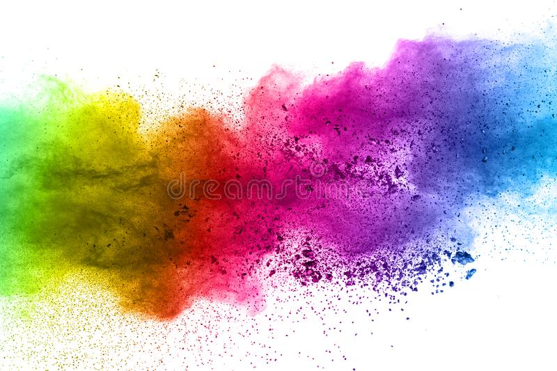 Multicolored powder explosion on white background. Colored cloud. Colorful dust explode. Paint Holi stock photography